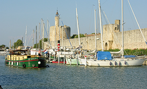 The boat harbour at Aigues-Mortes is located just outside the town's fortifications. Inland craft share the available berths with sailing boats.© Irène Plunkett