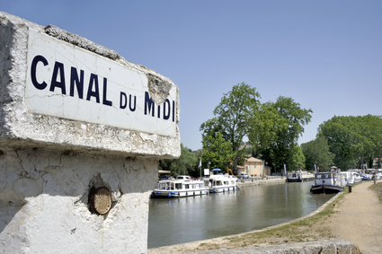 Southern France, Canal de Midi at the village of Capestang. Focused at the sign with the name of the canal.